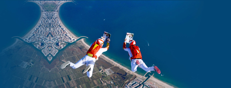 2 skydivers reading a magazine in freefall